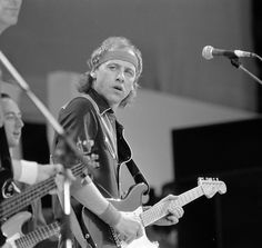 Mark Knopfler on stage with Dire Straits at the Live Aid concert, Wembley Stadium, London. July 1985