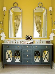 Yellow Bathroom + Gray Furniture + Mirrored Cabinet Doors + Silver Gilded Mirrors + Silver Pulls + Silver Faucets + White Marble Top + White Lamp Shades