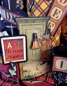 annes papercreations: Toilet paper roll spinner desktop organizer caddy using ABC Primer collection from Graphic 45 - tutorial. Close up picture by Anne Rostad. So fun puzzle the fussy cut outs together into a scene :-)