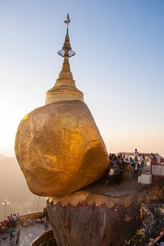 Places of Worship -  Myanmar- Le Rocher d'Or, or Kyaiktiyo Pagoda is a huge rock about 6 m in diameter, placed in equilibrium at 1200 m above sea level in Mon State (southern Burma). Wearing a small stupa is one of the main places of worship of the Burmese Buddhism. Pilgrims cover with gold leaf monolith reminiscent of the famous head hermit.