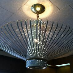 An original light fixture (since removed) in the 1955 Denver time capsule that @No Pattern Required posted