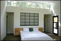 Love the large horizontal windows above the bed, and also the frosted window panel above the door.