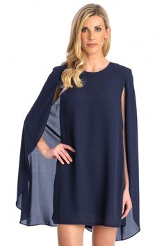 MARIELLA DRESS Style #USMK10129  $139.00 IN STOCK Navy cape dress takes elegance to whole new level. Sleeveless tunic under with a lightweight cape that drapes over arms and hits mid-thigh for a look that turn heads all night.