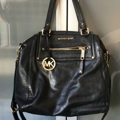 Michael Kors Black Leather Tote Deliciously soft black leather without a hardened shape of many MK bags. Comfortable on the shoulder, arm, or with crossbody strap. Comes with dustbag. Top zip. Exterior zip and cell pockets. Interior zip, wall and cell pockets. Measurements: 15 in w x 5.5 in d x 12.5 in h / Handle Drop: 7 in / This is used, few areas of wear but overall very clean, well cared for. MK tag is flawless, I never used and kept in dustbag. Slight wear on bottom, slight wear at…