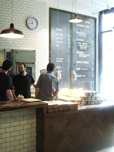 Meat & Bread features worn hardwood floors, subway-tiled walls, mounted animal heads, leather punching bag and metal chairs for a butcher-shop-meets-boxing-gym vibe. Owners Cord Jarvie and Frankie Harrington worked with architect Craig Stanghetta and brand experts Glasfurd & Walker to create the look in the historic Gastown neighborhood of Vancouver