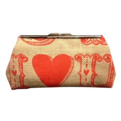 I LOVE YOU BURLAP CLUTCH This handmade clutch is made with a printed stabilized burlap. I love you is printed in bright red on tan burlap. The purse is lined in red cotton. The lining of the purse is finished with french seams. Price-$43. ESTIMATED SHIP TIME 2-5 days