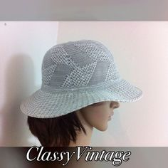 Vintage sun hat in pretty silver blue This pretty woven nylon silver blue and white vintage hat. Very clean. Vintage Accessories Hats