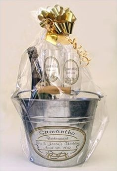 Cheers to a fun bridesmaid gift!  Personalized champagne flutes, a bottle of champagne and rustic bucket for chilling her treat!