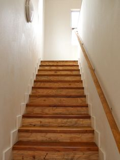 Stairs with salvaged wood treads - a welcome entrance to a garage apartment.