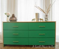 Dresser painted with 3 coats of Benjamin Moore Advance in Emerald Isle --liquid gold gilding around the outer frame (Martha Stewart brand in Brass)