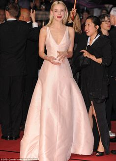Carey Mulligan's porcelain skin is offset by the red lipstick.  Her hair is worn down ~ elegant & smooth.  Plunging pink satin Christian Dior gown is worn at the premiere of THE GREAT GATSBY at the Cannes Film Festival 2013)
