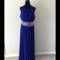 Formal Dress Beautiful royal blue dress. Stone and detail around waist. Keyhole on chest. Ties in back around neck. Slit up the middle of dress. Zipper in back. Brand new, never worn. Dresses