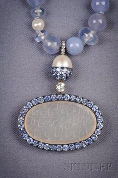 JAR Paris. Antique Islamic Intaglio and Gem-set Pendant Necklace, JAR, Paris, the necklace composed of chalcedony and pale sapphire beads weighing 125.88 cts., and Oriental pearls weighing 25.86 cts., suspending an antique chalcedony Islamic intaglio, framed by sapphires weighing 5.15 cts. and diamond melee, mounted in silver and gold, signed JAR PARIS. Estimate $15,000 - $20,000 / LOT SOLD $25,725 [SKINNER - SEP. 15, 2009] #JAR #JARParis #JoelArthurRosenthal
