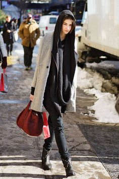 Layered knits with the hood pulled up make for a stylish getaway #streetstyle #NYFW #fashionweek