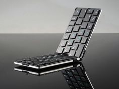 Ultra Thin Foldable Flyshark Bluetooth Keyboard is the Perfect Travel Companion - GetdatGadget Technology Design, Cool Technology, Technology Gadgets, High Tech Gadgets, Gadgets And Gizmos, Cool Gadgets, Radios, Cool Office Supplies, Bluetooth Keyboard