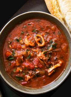 Calamari Tomato Stew! Calamari (squid) slow cooked in tomato sauce with onion, fennel, garlic, red wine, and parsley.