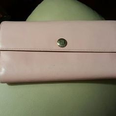 Kate Spade wallet This is a Kate Spade pink leather wallet from my non smoking home. It shows just a bit of wear on the corners (see picture) but it still looks great and there is tons of use left in it. kate spade Accessories