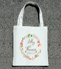 Modern Couple Floral Wreath Personalized Totes - Wedding Welcome Tote Bag via ilu.lily designs on Etsy. #weddings #weddingfavors #destinationweddings #weddingwelcomebags #welcomebags