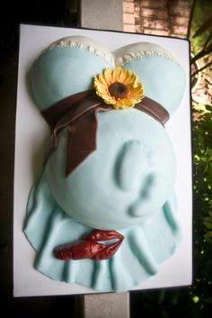 """Pregnant belly cake with feet. Special """"crawbaby"""" gumpaste crawfish."""
