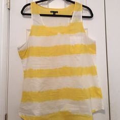 Yellow and white stripe tank top Yellow and white stripe tank top. Never worn but two little stains (2nd picture). GAP Tops Tank Tops