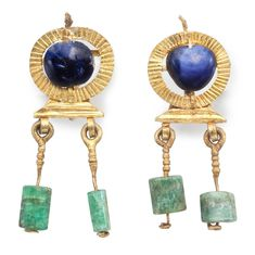A pair of Roman gold, sapphire and emerald earrings, circa 2nd-3rd century AD. Starting bid $2,400.