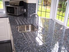 Stunning Blue Pearl granite worktops tightly matched to unusual room shape Blue Granite Countertops, Bathroom Countertops, Granite Kitchen, Kitchen Tiles, Kitchen Slab, Kitchen Backslash, Granite Slab, Kitchen Shelves, Kitchen Reno