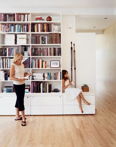 A less permanent, though no less effective, solution are the ten-foot-tall bookshelves on a freestanding wall of a luminous retreat in Sa. Tall White Bookshelf, Tall Bookshelves, Bookshelves In Living Room, Free Standing Wall, Piece A Vivre, Cool Walls, Wall Shelves, Open Shelves, Home Living Room