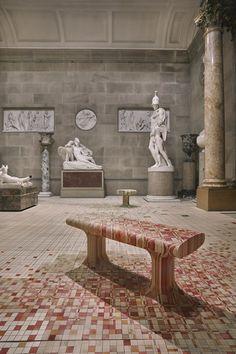 Raw Edges installs dye-soaked wooden floor across 19th-century sculpture gallery.