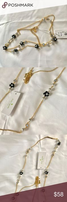 🆕 Kate Spade Precious Petals necklace Super cute dainty Kate necklace. Light blue charms & faux pearls. Hard to tell if petals are black or dark navy. NWT. kate spade Jewelry Necklaces