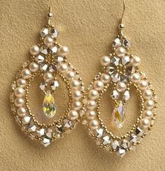 Dress Up or Dress Down with these delicate earrings created with pearls and crystals, and a center crystal drop. Skill Level: Novice Technique: Right Angle Weave Type: Earrings
