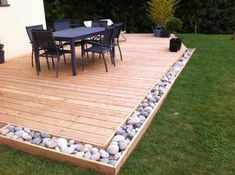 Perfect design to use with pallet deck except I would plant flowers and herbs instead of rocks!