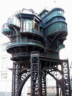 I don't know where this is located or who built it, but IT ROCKS. It's like steampunk married art nouveau and then everything rusted.