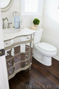 A budget makeover from DIY maven Kelly of View Along the Way. It really makes this tiny bathroom sparkle! || @Kelly at View Along the Way
