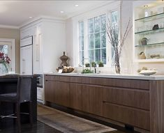 I love the idea of the open cabinet with glass shelves and lighting.