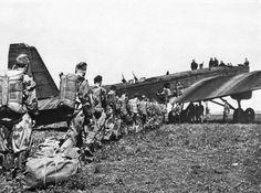 Soviet paratroopers boarding a Soviet Tupolev TB-3.