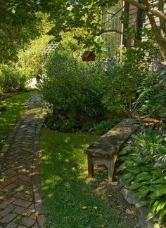 Peaceful Shady Garden...old brick walkway...hostas...old weathered bench...birdhouse. by maria.t.rogers