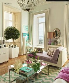 I love: pastel colors, chevron rug, chrome/glass coffee-table, chandelier