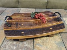 This handcrafted wood platter is made from the staves of a recycled wine barrel. It can be used to display fruit, cheeses, or just be a centre piece on a coffee table.
