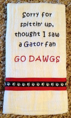 Have it say Sorry for spittin' up, thought I saw a BYU fan.   Go Utes   UGA Burp Cloth by ThePersonalDesign on Etsy, $10.00