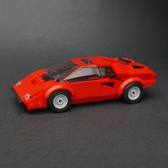 Red looks good on more than just Ferraris Race around in this sexy red Lamborghini Countach by Jonathan Elliott! Legos, Supercars, Lego Cars, Lego Auto, Lego Sports, Red Lamborghini, Lamborghini Gallardo, Amazing Lego Creations, Lego Speed Champions