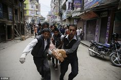 Men carry an injured person through the streets of Kathmandu, Nepal after a magnitude earthquake caused massive damage in the city Nepal, Political Issues, West Bengal, Mount Everest, Street View, Pictures, Helfer, Mustang, People