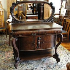 Victorian Era Quarter Sawn Oak Sideboard with Oval Mirror and Cherubs