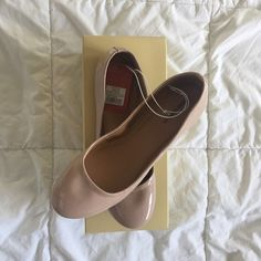 Nude ballet flats, NIB 🎉HP🎉 Ballet flats, purchased for a wedding but wore a different pair of shoes. Never worn. Minor snag in the stitching along the top of shoe (unable to capture clearly with my camera). Mossimo Supply Co Shoes Flats & Loafers