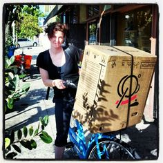 Car during her last day at the Flying Pigeon shop, delivering some stuff in a Brompton box.