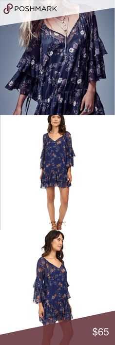 """Free People """"Sunsetter"""" Dress A bohemian Free People shift dress with a vintage-inspired floral print. Ruffled 3/4 sleeves. Tie front keyhole. Optional slip-dress lining.  Fabric: Crinkled chiffon. Shell: 100% nylon. Lining: 100% rayon. Hand wash or dry clean. Free People Dresses Mini"""