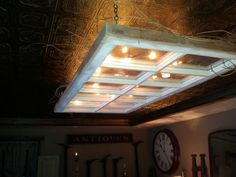 ANOTHER USE FOR OLD WINDOWS.I hung this from my ceiling with star lights laying on top. Looks like skylight and looking at the stars! Cute for porches too. Old Window Projects, Home Projects, Old Windows, Windows And Doors, Old Window Decor, Old Doors, Rustic Lighting, Star Lights, New Wall