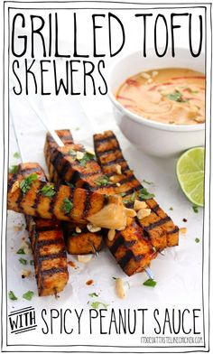 Grilled Tofu Skewers with Spicy Peanut Sauce! The tofu can marinate in the fridge for up to 3 days, then just grill on your BBQ when ready to enjoy. These also work great as a party appetizer. #itdoesnttastelikechicken #veganrecipes #veganbbq #tofurecipe via @bonappetegan