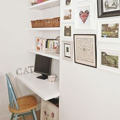 A home office has been cleverly created in an alcove, with a fitted desk and shelving on an upstairs landing. A display of pictures makes the area feel cosy.