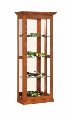 Amish Made Glass Sliding Door Curio Cabinet Custom made curio cabinet in choice of wood and finish. Select interior lighting options, number of shelves and more. #DutchCrafters