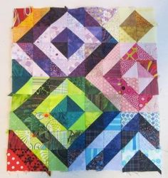 Love this half square triangle quilt!
